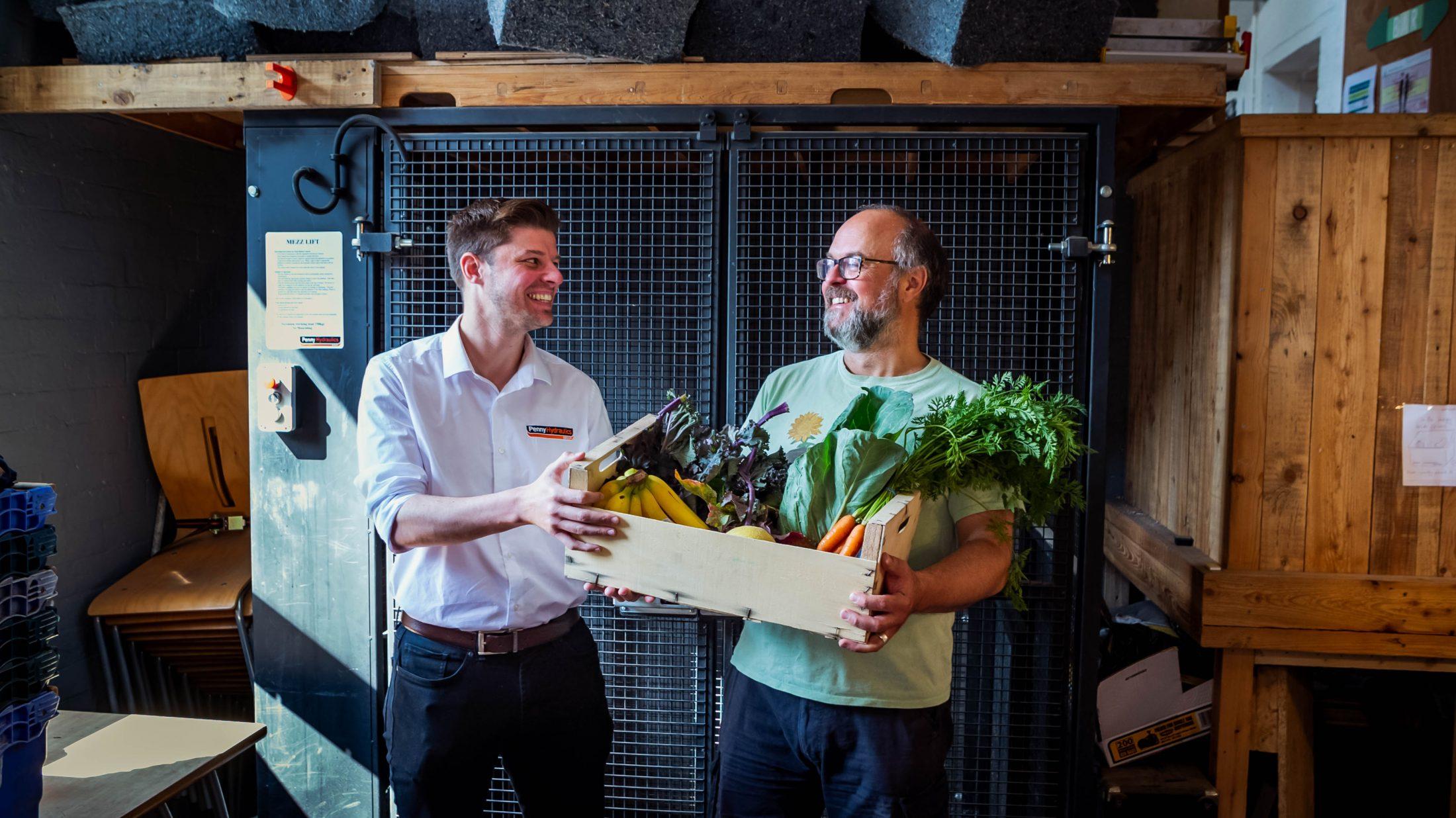 Men holding Vegetables